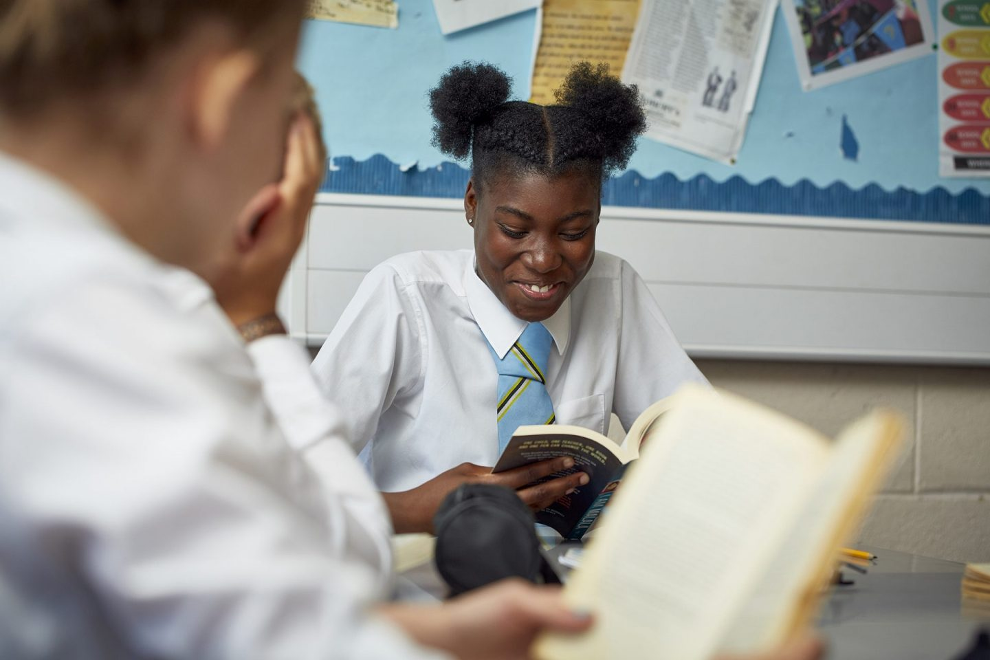 student reading a book - English curriculum